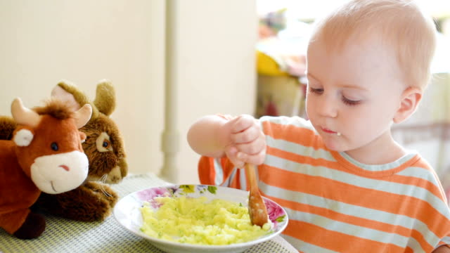 little boy eating mashed potatoes - mashed potatoes stock videos & royalty-free footage
