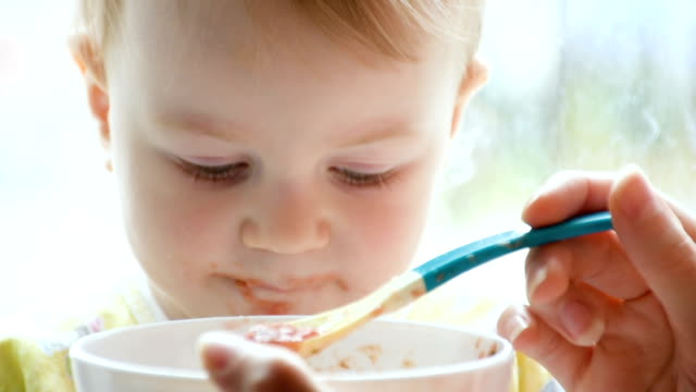 little boy eating soup - spoon stock videos & royalty-free footage