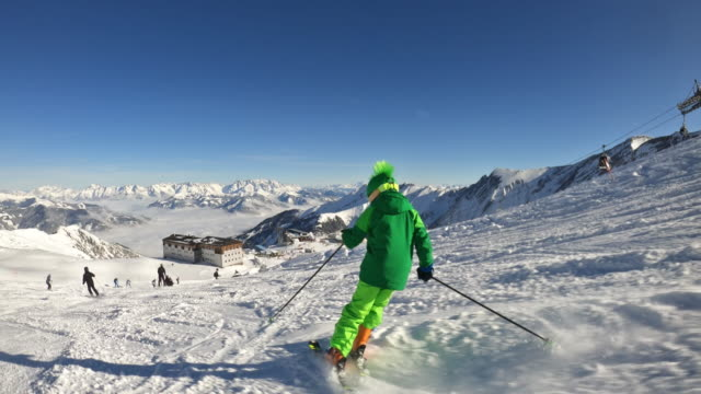 little boy enjoying skiing at glacier in the alps - ski slope stock videos & royalty-free footage