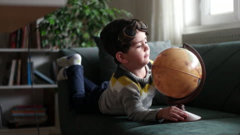 little boy examines the map - ethereal stock videos & royalty-free footage