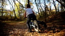 Little boy falling down from a bike