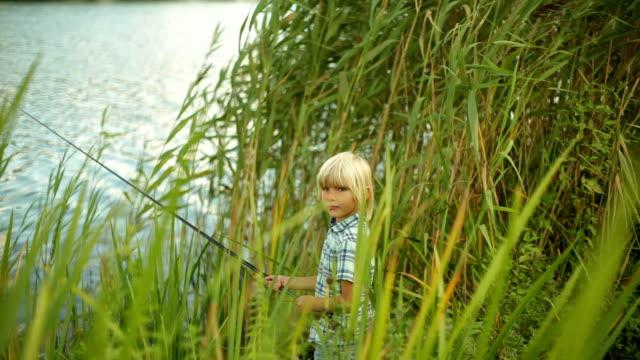 vídeos y material grabado en eventos de stock de little boy fishes - pesca