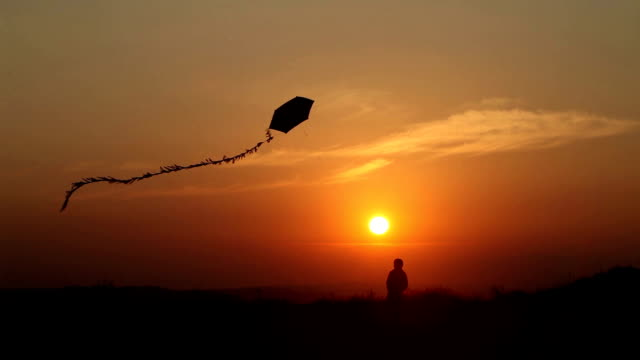 little boy flying a kite at sunset - kid with kite stock videos & royalty-free footage