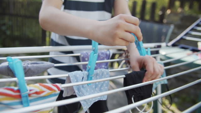 little boy hanging face masks on the drying rack - hanging stock videos & royalty-free footage
