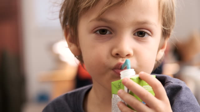 little boy having a carton of milk or juice - juice drink stock videos & royalty-free footage