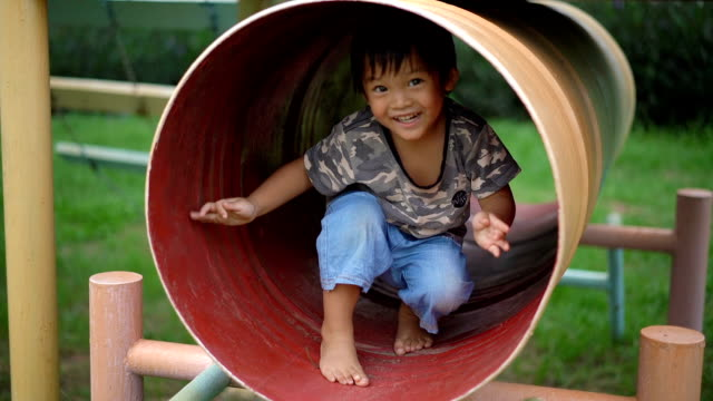 slo mo little boy having fun on a slide in park. - 2 3 years stock videos & royalty-free footage