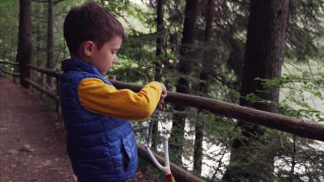 little boy holding sling with stone - catapult stock videos & royalty-free footage