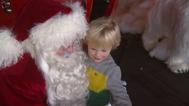 little boy hugging santa at john hancock center on november 30 2013 in chicago illinois - father christmas stock videos & royalty-free footage