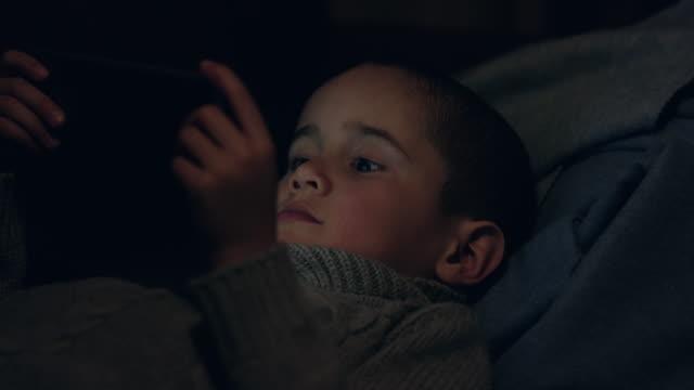 Little Boy in a Blanket Fort