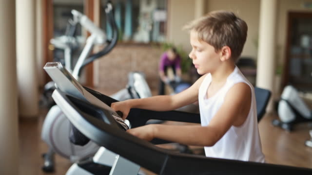 little boy in gym running on treadmill - exercise room stock videos & royalty-free footage