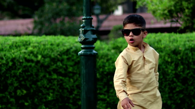little boy in sunglasses and having fun dancing in summer park - one boy only stock videos & royalty-free footage