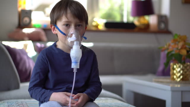 little boy in the inhalation mask with breathing troubles - lung stock videos & royalty-free footage