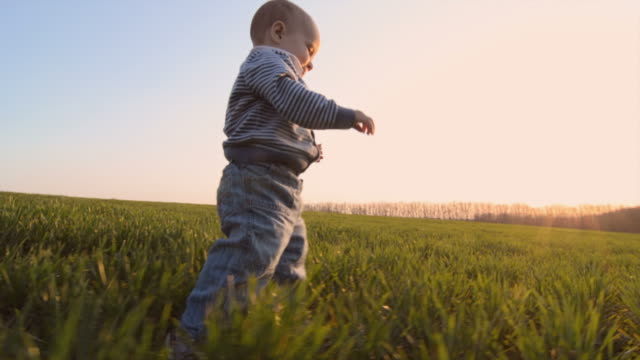 little boy is making his first steps - steps stock videos & royalty-free footage