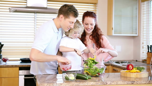 little boy preparing food with his parents - eating utensil stock videos and b-roll footage
