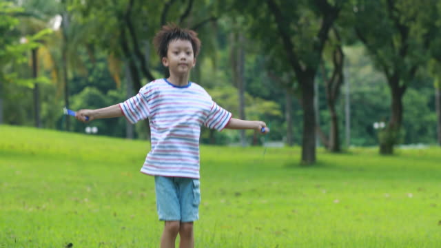 little boy jumping rope on grass - rope stock videos & royalty-free footage