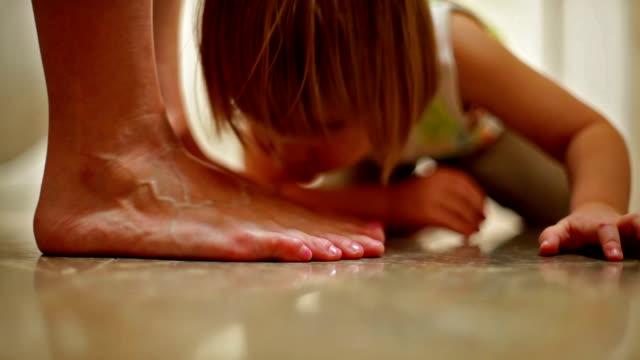 little boy kissing mother's feet