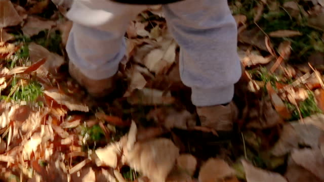 a little boy learns to walk,close up - baby boys stock videos & royalty-free footage