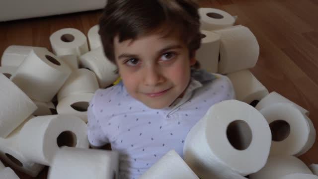 kleiner junge liegt in toilettenpapier - weichheit stock-videos und b-roll-filmmaterial