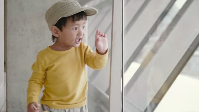 a little boy looks at the planes at the airport. - one baby boy only stock videos & royalty-free footage