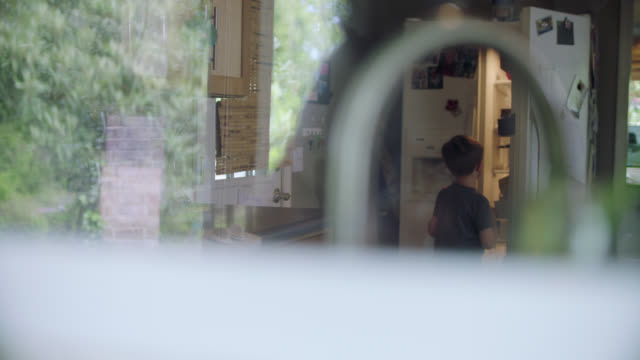 little boy looks through the refrigerator for snacks. - choosing stock videos & royalty-free footage