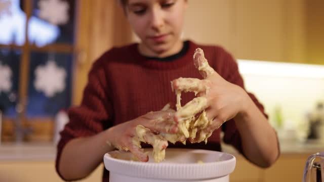 little boy making muffins in kitchen - kitchen worktop stock videos & royalty-free footage
