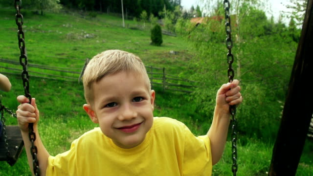 little boy on a swing - one boy only stock videos and b-roll footage