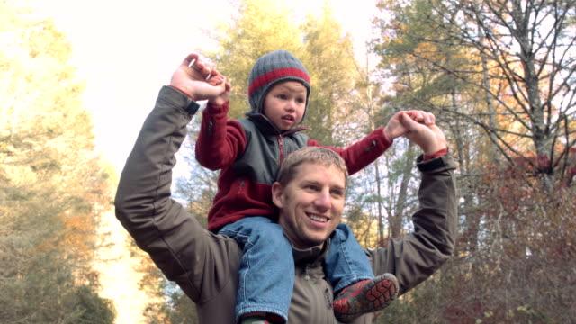 Little Boy On Daddy's Shoulders