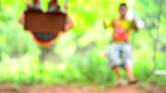 little boy on swing - soft focus stock videos & royalty-free footage