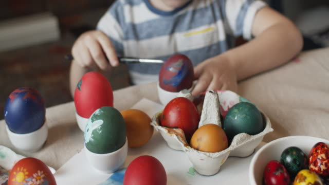 little boy painting on easter eggs - easter stock videos & royalty-free footage