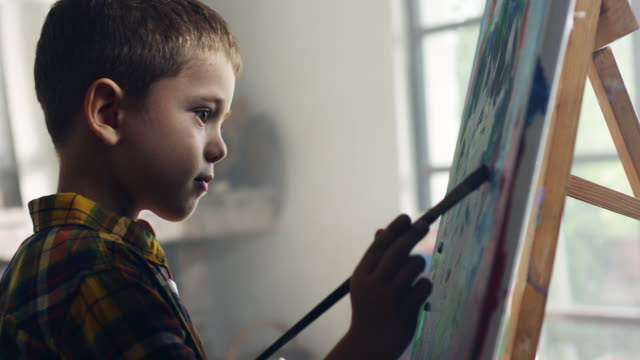 little boy painting - boys stock videos & royalty-free footage