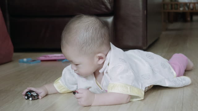 little boy(6-11 months) playful on the floor - 6 11 months stock videos & royalty-free footage