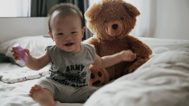 little boy playing at home with soft teddy bear toys - teddy bear stock videos & royalty-free footage