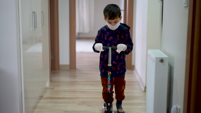 little boy playing at home with surgical mask and surgical gloves - riding scooter with - 4 5 years stock videos & royalty-free footage