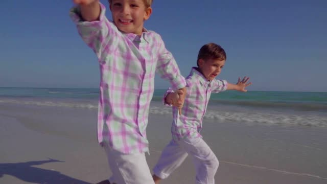 little boy playing at the beach in slow motion - the florida keys stock videos & royalty-free footage