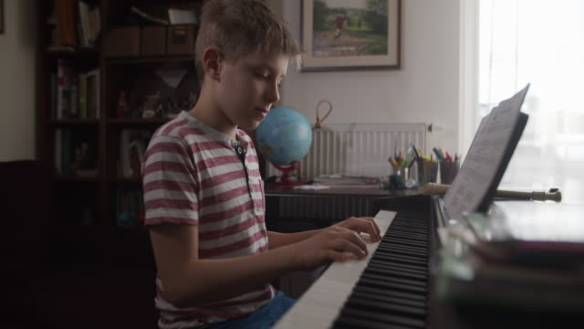 little boy playing digital piano - imgorthand stock videos & royalty-free footage