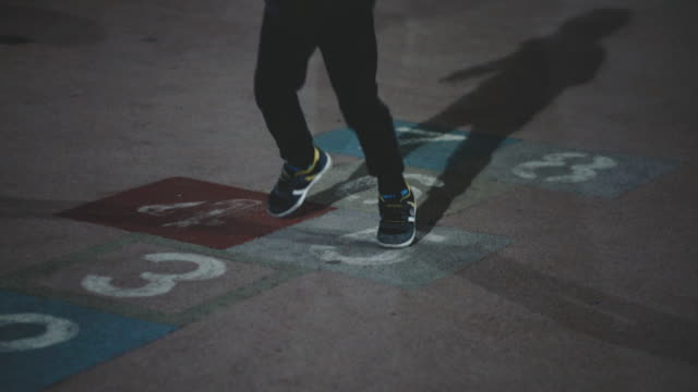 little boy playing hopscotch in the playground - shadow stock videos & royalty-free footage