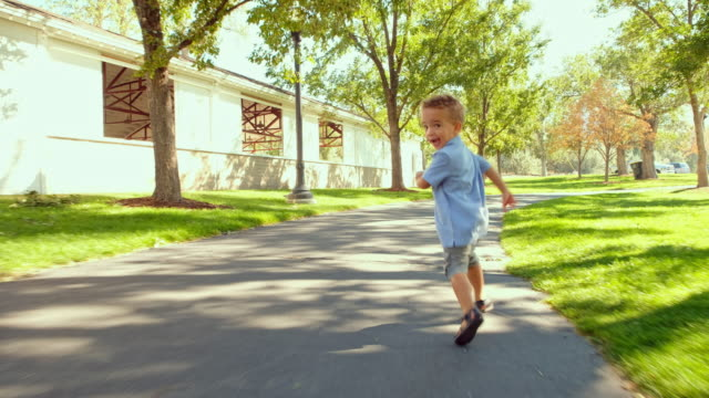 Little Boy Playing in a Park