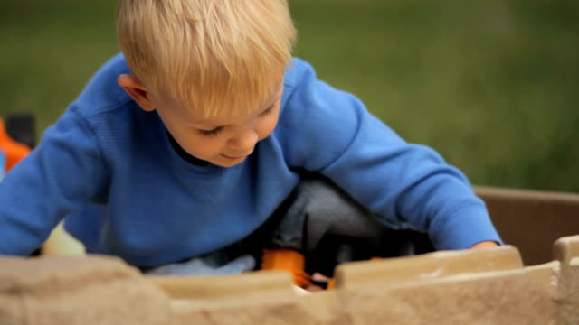 little boy playing in sandbox - sand pit stock videos and b-roll footage
