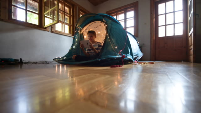 little boy playing in tent in living room - wooden floor stock videos & royalty-free footage