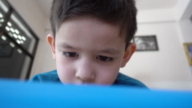 little boy playing on digital tablet - net sports equipment stock videos & royalty-free footage