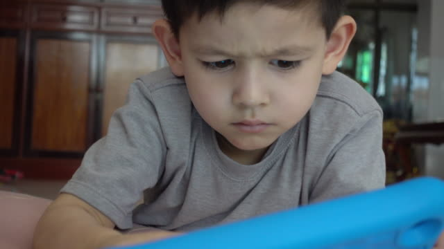 little boy playing on digital tablet - childhood stock videos & royalty-free footage