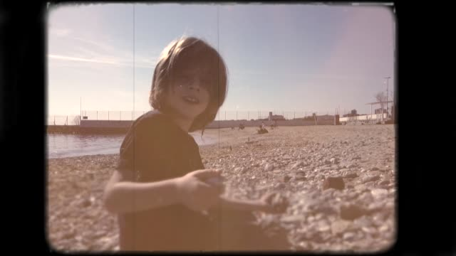 little boy playing on the beach. 8mm footage. - nostalgia stock videos & royalty-free footage