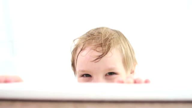 little boy playing peak-a-boo in the bath - peeking stock videos and b-roll footage