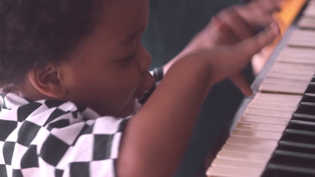 little boy playing piano - skill stock videos & royalty-free footage