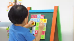 Little boy Playing with Alphabets