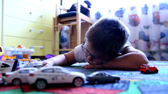 little boy playing with cars - wooden floor stock videos & royalty-free footage