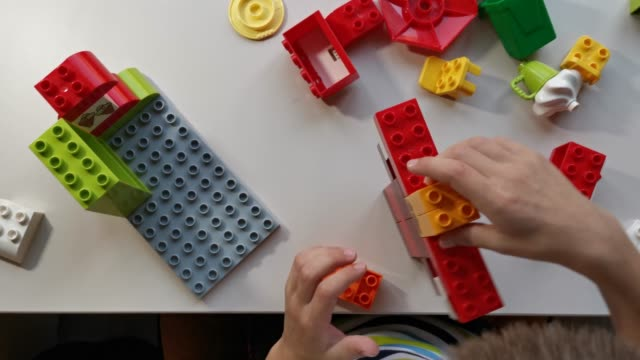 little boy playing with colored cubes - pencil sharpener stock videos & royalty-free footage