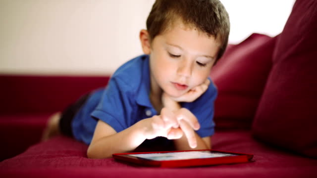 little boy playing with digital tablet - one boy only stock videos & royalty-free footage