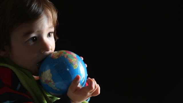 little boy playing with globe - selimaksan stock videos & royalty-free footage