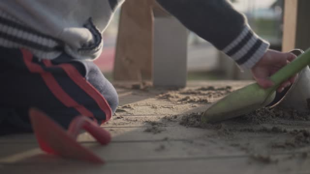 little boy playing with sand at a playground - preschool stock videos and b-roll footage